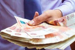 Money in hands Stock Photos