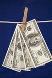 Money hanging on a clothesline Royalty Free Stock Photo