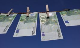 Money hanging on a clothesline. Several 100 euro banknotes hanging on a clothesline Stock Images