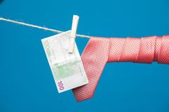 Tongs, money and tie with knot, on a rope stock images