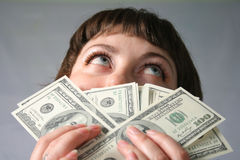 Money has no smell!. Woman with hand of money. Open one's eyes wide Royalty Free Stock Photo