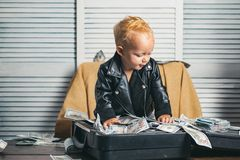 Money has no smell. Small child do business accounting in startup company. Little entrepreneur work in office. Boy child. With money case. Little boy count royalty free stock photography