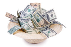 Money in hat Royalty Free Stock Image