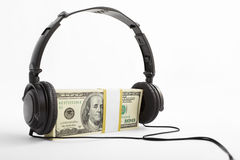 Money and headphone Stock Image