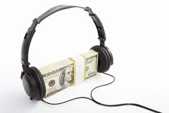 Money and headphone Stock Photo