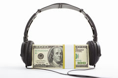 Money and headphone Stock Photography