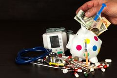 Money for health care. Financing hospital treatment. Money and medicines. Royalty Free Stock Photo