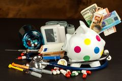 Money for health care. Financing hospital treatment. Money and medicines. Stock Photos