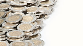Money heap (close-up picture). A heap consisting of 2-Euro coins isolated on a white background stock images