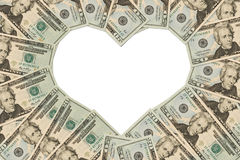 Money Heart. Twenty dollar bills making a heart symbol on a white background, money heart Royalty Free Stock Images