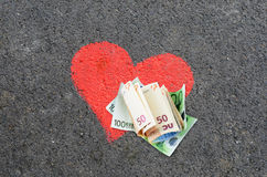 Money heart Stock Photos