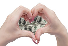 Money heart and hands. Woman hands in the shape of a money heart Stock Photography
