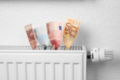 Money on heating battery. Money on the heating battery Royalty Free Stock Photos