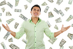 Money from Heaven. Stock image of money falling around young man Royalty Free Stock Photo