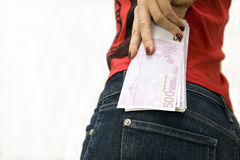 Money in the hip-pocket. Of a woman Royalty Free Stock Image