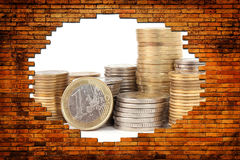 Money for a hole in the brick wall Stock Photo