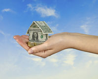 Money home in hand Royalty Free Stock Photography