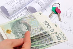 Money, home keys and construction drawings of house Stock Photo