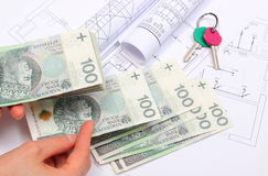 Money, home keys and construction drawings of house Stock Images
