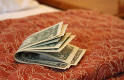 Money on hotel bed Royalty Free Stock Image