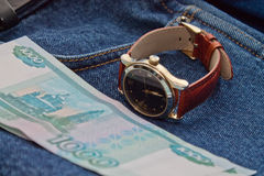 Money and hours on the jeans Royalty Free Stock Images