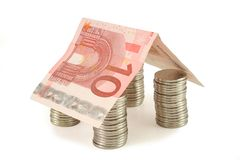 Money house 1. House made of coins and euro banknote - real estate concept (isolated, clipping path stock photo