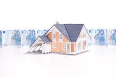Money and house Royalty Free Stock Photos