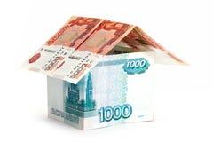 Money house. On white Stock Images