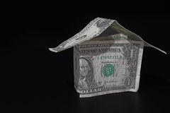Money House. A house made out of one dollar bills - Realty / Investment Concept Stock Photos
