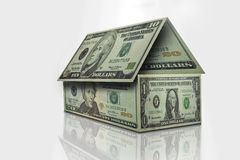 Money House. Dollar bills placed together to form a house Stock Photos