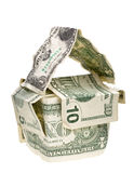 Money house. Conceptual house made from crumpled dollar banknotes isolated on white Royalty Free Stock Photo