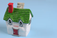 Money into the house Royalty Free Stock Image
