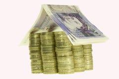 Money house. Isolated on white - macro stock photos