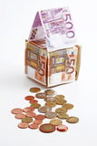 Money house with coins Stock Image