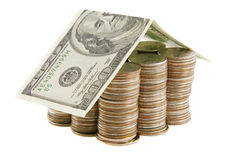 Money house from coins and dollars Royalty Free Stock Image