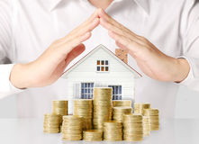 Money house from the coins stock photo