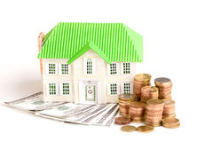 Money for House. House Concept: Money - Dollar Bills and Coins - and an Architectural Model of the Cosy House Stock Photos