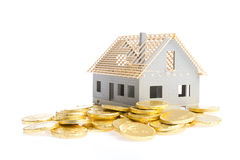 Money for house. Family house on pile of money Royalty Free Stock Photo