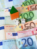 Money house gamble. Real estate finance concept with mini house, dice and Euros. Gambling Stock Image