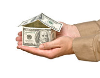 Money house in hands Royalty Free Stock Photos
