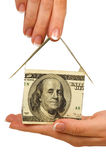 Money house in hands Stock Image