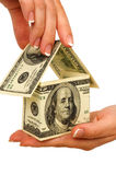 Money house in hands Stock Images