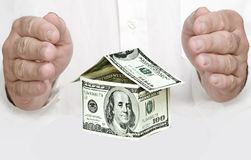 Money house and hands Royalty Free Stock Image