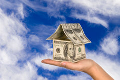 Money house held against the sky Stock Photo