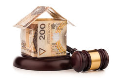 Money house  and judge gavel isolated on white Stock Photos