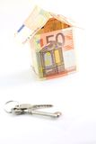 Money house and keys Stock Photos