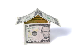 Money house made of dollar bills. On white background Royalty Free Stock Photography