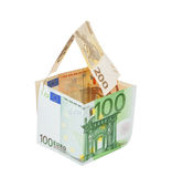 Money house made of euro money concept symbol of wealth. On a wh Royalty Free Stock Photos
