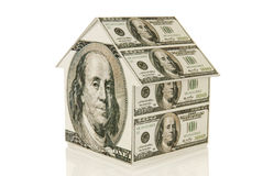 Money House. A house made out of one hundred dollar bills on a white background Royalty Free Stock Photos