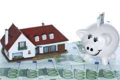 Money house and piggy bank Royalty Free Stock Images